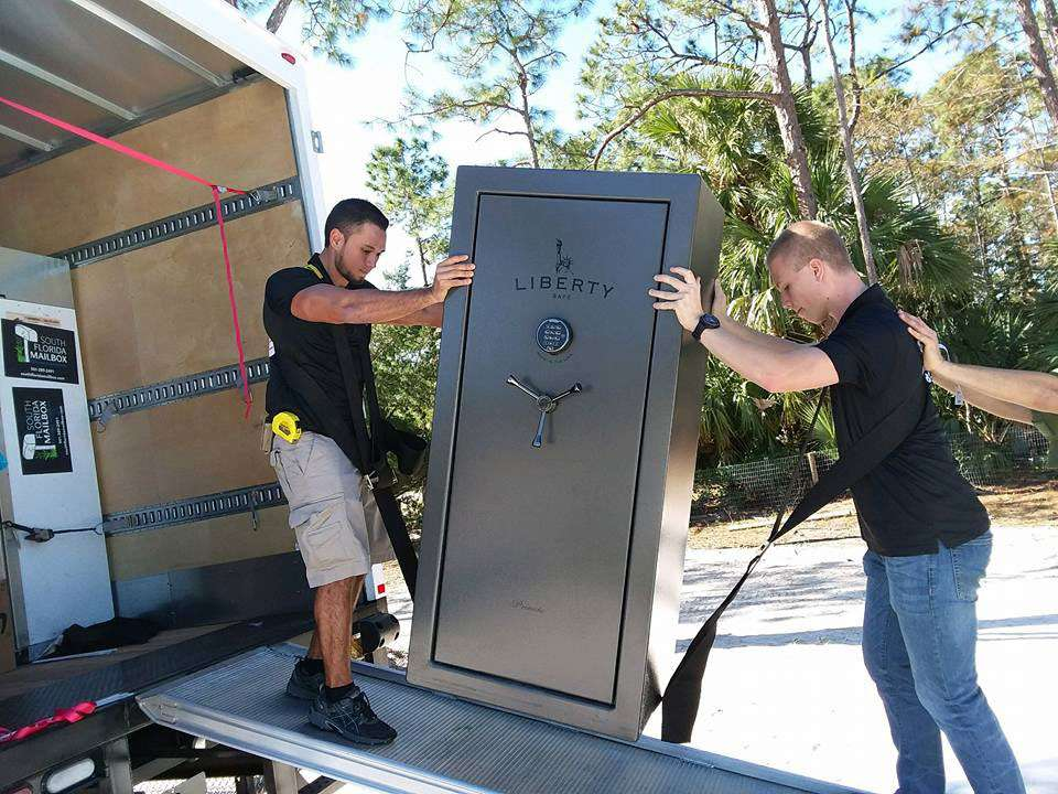 Professional Movers Handling a Safe