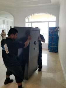 Professional Movers Moving a Safe